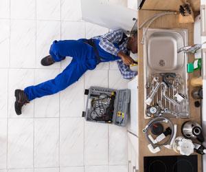 Man fixing faucet